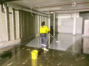 Application of top coat onto floor space