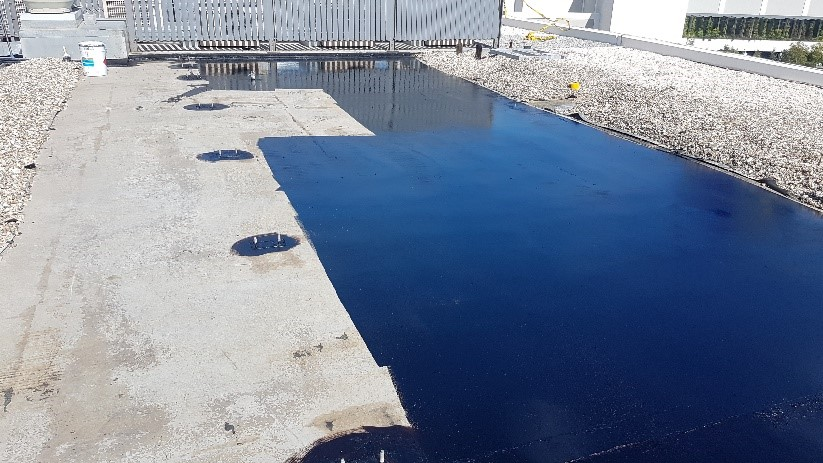 Image 3 Application of primer in progress before installation of torch on waterproofing membrane system